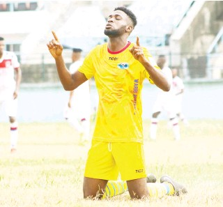 ??  ?? Charles Atsemene of Warri Wolves cel­e­brates his goal against FC Ifeany­iUbah in the aborted 2020 Nige­ria Pro­fes­sional Foot­ball League sea­son