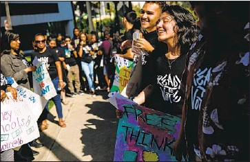 ?? Photographs by Marcus Yam Los Angeles Times ?? ASHLEY GRANADOS, right, a Roosevelt High junior, and other students rally at L.A. Unified headquarters, calling for the first steps to be taken toward lowering the voting age to 16 for school district elections.