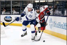 ?? PAUL VERNON   Associated Press ?? David Savard, right, goes for the puck behind Lightning forward Blake Coleman while with the Blue Jackets in a game Tuesday.
