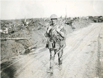 ?? — GEORGE METCALF ARCHIVAL COLLECTION/CANADIAN WAR MUSEUM FILES ?? A muddy and exhausted Canadian soldier walks back from the front line after the battle of Vimy Ridge. Next year will be the 100th anniversary of the battle, which helped define Canada.