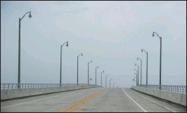 ?? Washington Post photo by Carolyn Van Houten ?? Roads stand nearly empty in Hutchinson Island, Florida, while Hurricane Dorian churns off the coast in the Atlantic Ocean on Monday.