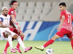 ??  ?? ↑ Sharjah and Tractor players in action during their AFC Champions League match in Sharjah on Saturday.