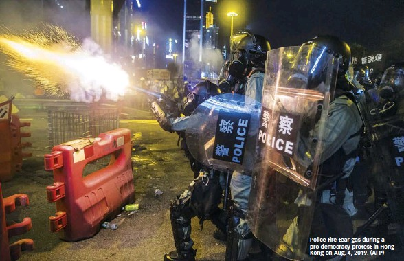 ??  ?? Police fire tear gas during a pro-democracy protest in Hong Kong on Aug. 4, 2019. (AFP)