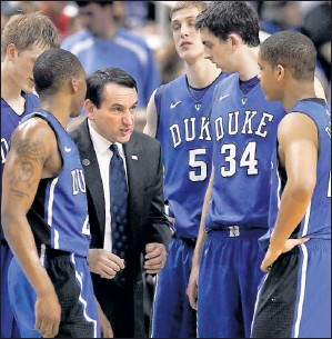 ?? By Mark Dolejs, US Presswire ?? Closing in: Duke coach Mike Krzyzewski, directing his team during a March 13 game, needs two wins to tie his mentor, Bob Knight, for the Division I record for coaching victories at 902.