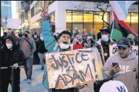 ?? CHICAGO SUN-TIMES VIA THE ASSOCIATED PRESS ?? Dozens of protesters marched Thursday in Chicago after the release of videos showing a teen being fatally shot by police.