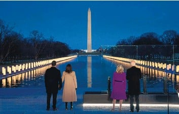 ?? EVAN VUCCI/ASSOCIATED PRESS ?? Vice President-elect Kamala Harris and her husband, Doug Emhoff, and President-elect Joe Biden and his wife, Jill Biden, participate in a COVID-19 memorial at the Lincoln Memorial Reflecting Pool on Tuesday.