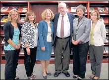 ??  ?? Harkins is congratulated by Joseph R. Hyde Library Learning Center staff Laura Bontrager (left), Maxine Molasky, Bonnie Barnes, Barbara Presley and Nancy Arant during the Harkins Archives dedication.