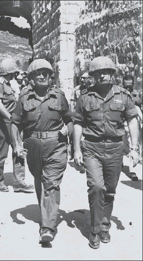 ?? REUTERS ?? aders Uzi Narkis, Moshe Dayan and Yitzkak Rabin enter Jerusalem's Old City through the Israeli forces captured the Arab part of the city in June 1967. Rabin and another commander in eir terms as prime minister trying to trade their 1967 land gains for...