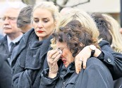 ??  ?? Martin McGuinness's wife Bernadette weeps at his funeral in Londonderry on Thursday. Right: Phyllis Carrothers, whose policeman husband, Dougie, was murdered by the IRA in 1991