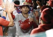 ?? NICK WASS AP ?? The Philadelphia Phillies' Brad Miller is congratulated in the dugout for his two-run home run against the Washington Nationals during the ninth inning Tuesday in Washington.