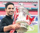 ??  ?? WINNER Mikel Arteta with the FA Cup
