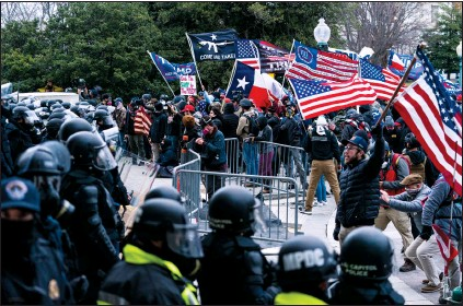 ?? AP PHOTO MANUEL BALCE CENETA ?? Supporters of President Donald Trump are confronted by U.S. Capitol Police officers outside the Capitol, on Wednesday in Washington.