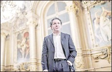 ?? — AFP photo ?? Dudamel poses during a photo session at the opera Garnier in Paris.