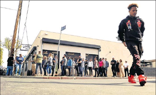 """?? Photographs by Christina House For The Times ?? THE LINE stretches down the sidewalk at Locol. The restaurant's co-founder Roy Choi says the """"the energy of Watts, this specific neighborhood, is on the block."""""""