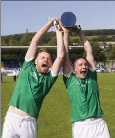 ??  ?? Alan Daly and Conor Healy lift the cup after Donard-The Glen's narrow victory over Coolkenno in Aughrim.