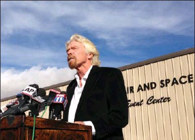?? THE ASSOCIATED PRESS ?? Billionaire Virgin Galactic founder Richard Branson salutes the bravery of test pilots and vows to find out what caused the crash of his prototype space tourism rocket that killed one crew member and injured another during a news conference Saturday in...
