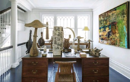 ??  ?? 1920s fsh cabinet. Bottomright Designer Windsor Smith commissioned the dressing-area wallpaper. The burr cabinet is a vintage fnd Below Nature-themed pieces such as resin tusks and wooden mushrooms are displayed on the landing. Bottom left Bruno with his