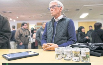 ??  ?? A customer waits to purchase marijuana at Harborside, one of California's largest and oldest dispensaries of medical marijuana, in Oakland.