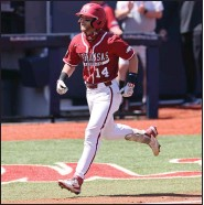?? (Photo courtesy Ole Miss Athletics) ?? Third baseman Cullen Smith went 2 for 3 with 3 runs and 3 RBI to help the No. 2 Razorbacks to an 18-14 victory over Ole Miss on Sunday in Oxford, Miss. Arkansas won two of three to take the series.
