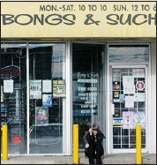 ?? Ted Rhodes, Calgary Herald ?? Shauna Ferguson, an employee at Bongs and Such, takes a smoke break outside the 18th Avenue N.E. outlet Thursday.