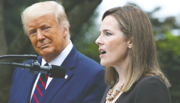 ?? Chip Somodevila / Getty Images ?? Judge Amy Coney Barrett speaks after U. S. President Donald Trump announced Saturday that she will be his nominee to the Supreme Court. If confirmed, Coney Barrett would give the court a 6-3 conservative majority, which Trump wants to use to his advantage for potential election cases.