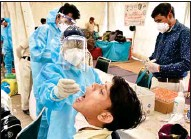 ?? PIC/MPOST ?? Healthcare workers at Anand Vihar Bus Terminal in New Delhi on Wednesday