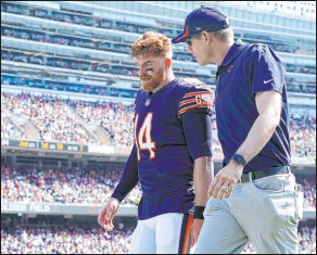 ?? Nam Y. Huh The Associated Press ?? Chicago Bears quarterback Andy Dalton leaves the field with a knee injury during Sunday's game against the Cincinnati Bengals.