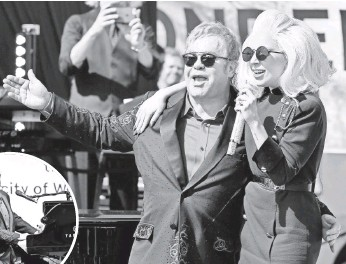 ?? KEVIN WINTER, GETTY IMAGES, FOR AOL ?? Lady Gaga joins Elton John for a performance of John's beloved classic Don'tLet the Sun Go Down on Me at a free outdoor show Saturday on the Sunset Strip.
