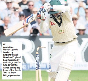 ?? AP ?? Australia's Nathan Lyon is bowled by England's Mark Wood as England beat Australia by an innings and 78 runs to win the Ashes during day three of the fourth Test at Trent Bridge yesterday.