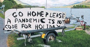 ??  ?? A sign painted on the side of a road in Lochaber, near Glen­coe, ear­lier in lock­down