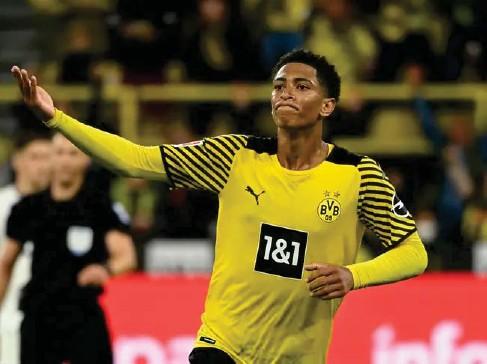?? (AFP) ?? Jude Be ll ingham celebrates scoring for Borussia Dortmund