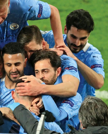 ?? AFP ?? Blue is the colour: City players and manager Pep Guardiola embrace after Phil Foden's superb winner against Dortmund
