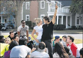 ?? Katie Falkenberg Los Angeles Times ?? REHEARSING on a Warner Bros. backlot, the production's Sandy and Danny, Hough and Tveit, strike a pose. During the broadcast, action will range across two soundstages and the backlot.