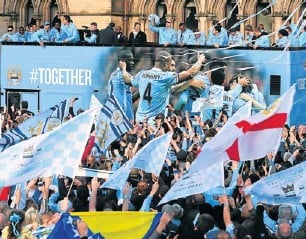 ?? Picture: GETTY IMAGES ?? BLUE MONDAY: The players of Manchester City leave Manchester Town Hall in an open-top bus for the start of their victory parade around the streets of Manchester on Monday