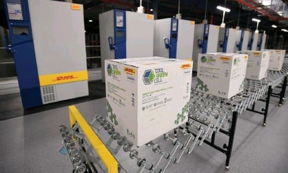 ?? Photograph: Joel Carrett/AAP ?? Covid-19 vaccine at a DHL facility in Sydney. The government is relying heavily on contractors to aid its vaccine rollout.