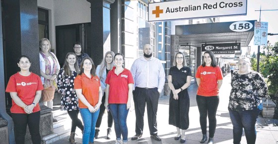 ?? Picture Bev Lacey ?? MOVING IN: Australian Red Cross has relocated to 154 Margaret Street. Outside their new offices are (back row) Charlene Keller (left) and Karla Draper, (second row) Sarah Berardo and Tiaro Cyrnock, (front, from left) Zeynad Aria, Mary-Ellen Middleton, Tahlia Bligh, Luke Yuginovich, Jade Stanley, Abigail Eberhard and Teagan McDonald.