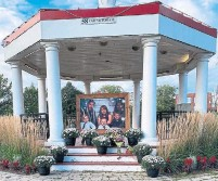 ?? ELIZABETH SMITH-MCCROSSIN VIA THE CANADIAN PRESS ?? A Sears family portrait was placed in a gazebo in downtown Amherst, N.S., to honour the family that died in a fire Sunday.