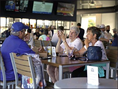 ?? THE ASSOCIATED PRESS ?? Baseball fans gather in the Bullpen Club at George M. Steinbrenner Field before a spring training exhibition baseball game between the New York Yankees and the Toronto Blue Jays in Tampa, Fla.