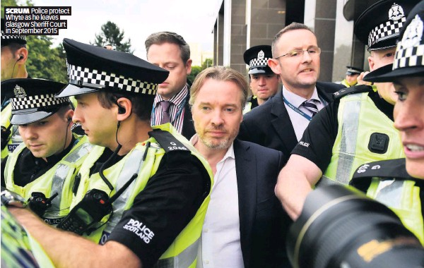 ??  ?? SCRUM Police protect Whyte as he leaves Glasgow Sheriff Court in September 2015