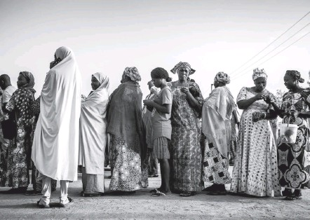 ?? LUIS TATO/AGENCE FRANCE-PRESSE/GETTY IMAGES ?? Women line up to vote in Yola, Nigeria, last year. Nigeria generally supports family-planning efforts, but on Tuesday it co-hosted an event in New York featuring Valerie Huber, a Trump official leading the push to refocus U.S. global health policy away from reproductive rights.