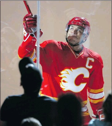 ?? Colleen De Neve, Calgary Herald ?? With a resigned look, Jarome Iginla passes his stick over the glass to fans after being named the first star on Wednesday. Despite a win, the Flames were eliminated.