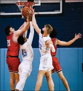 ?? JAMES BEAVER/FOR MEDIANEWS GROUP ?? Souderton's Aleks Smith (21) reaches up for a rebound with North Penn's Tehran Wright (45) and Josh Jones (23) battling for position in a reent game.