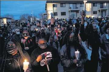 ?? PHOTOS BY THE ASSOCIATED PRESS ?? Protests have continued in Brooklyn Center, Minn., since former police officer Kim Potter was charged Wednesday with second-degree manslaughter in the death of Daunte Wright during a traffic stop.