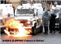 ??  ?? MASKS SLIPPING Violence in Belfast
