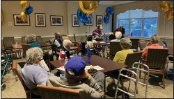 ?? COURTESY OF THE HICKMAN FRIENDS SENIOR COMMUNITY ?? Residents at the Hickman Friends Senior Community celebrate its 130year anniversary by listening to some music.