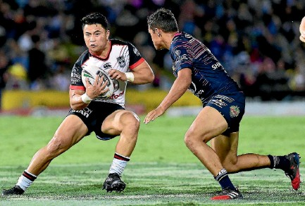 ?? PHOTO: PHOTOSPORT ?? Warriors halfback Mason Lino takes on the Cowboys defence in the NRL match in Townsville on Saturday night.