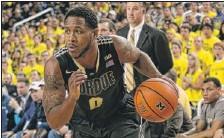 ?? | GETTY IMAGES ?? Terone Johnson brings the ball up the court during the second half of a recent loss at Michigan.