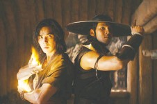 ??  ?? Ludi Lin, left, and Max Huang star in the action-adventure film version of the gruesome video game Mortal Kombat. It turns out both are a shrine to extreme violence and uninspired catchphrases.