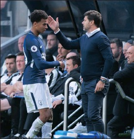 ?? Picture: PETER POWELL, EPA ?? NICE ONE, PLAYER: Dele Alli is congratula­ted by coach Mauricio Pochettino after being substitute­d at St James Park yesterday.