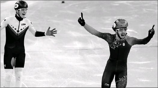 ?? David J. Phillip/The Associated Press ?? Samuel Girard of Canada celebrates as he crosses the finish line ahead of John-Henry Krueger of the United States in the men's 1,000 meters short track speedskating final in the Gangneung Ice Arena at the 2018 Winter Olympics in Gangneung, South Korea.